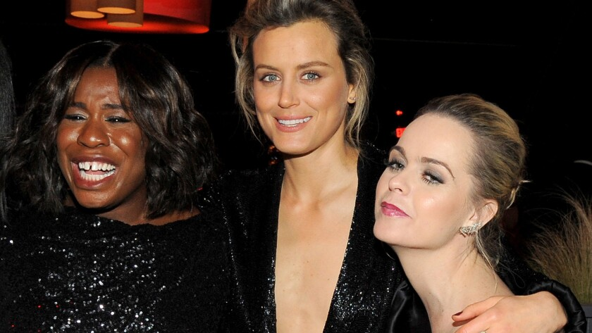 """Supporting TV actress nominee Uzo Aduba, left, Taylor Schilling and Taryn Manning of """"Orange Is the New Black"""" attend the Weinstein Co. and Netflix Golden Globes party."""