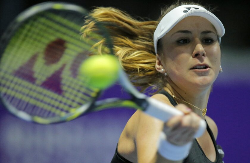 Belinda Bencic of Switzerland returns the ball to Annika Beck of Germany during the St. Petersburg Ladies Trophy-2016 tennis tournament match in St. Petersburg, Russia, Thursday, Feb. 11, 2016. (AP Photo/Dmitri Lovetsky)
