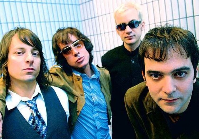 Fountains of Wayne reunited Wednesday to honor the late Adam Schlesinger, far right.