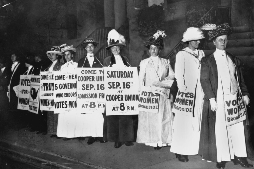 In this September 1916 file photo, demonstrators hold a rally for women's suffrage in New York.