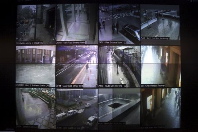 This Tuesday, Feb. 19, 2013 photo shows a detail of a video wall that shows New York city police officers an interactive map of the area, security footage from nearby cameras, locations where high radiation levels are detected and whether any other threats have been made in New York. The Domain Awa