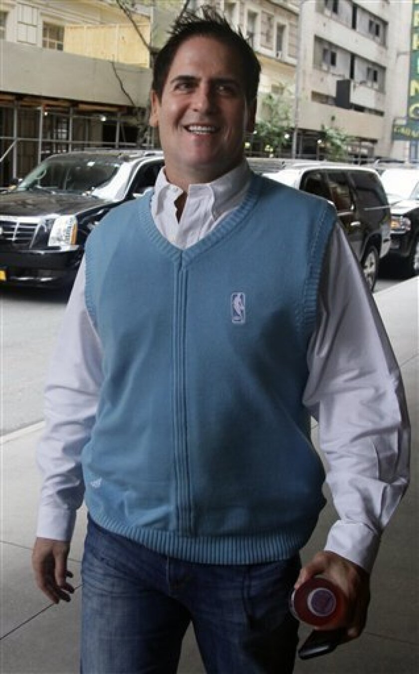 """Mark Cuban, owner of the Dallas Mavericks basketball team, arrives for labor talks Tuesday, Oct. 4, 2011 in New York. Owners and players arrived for a """"very huge day"""" in the NBA, with perhaps the fate of the league's 82-game schedule at stake. (AP Photo/Bebeto Matthews)"""