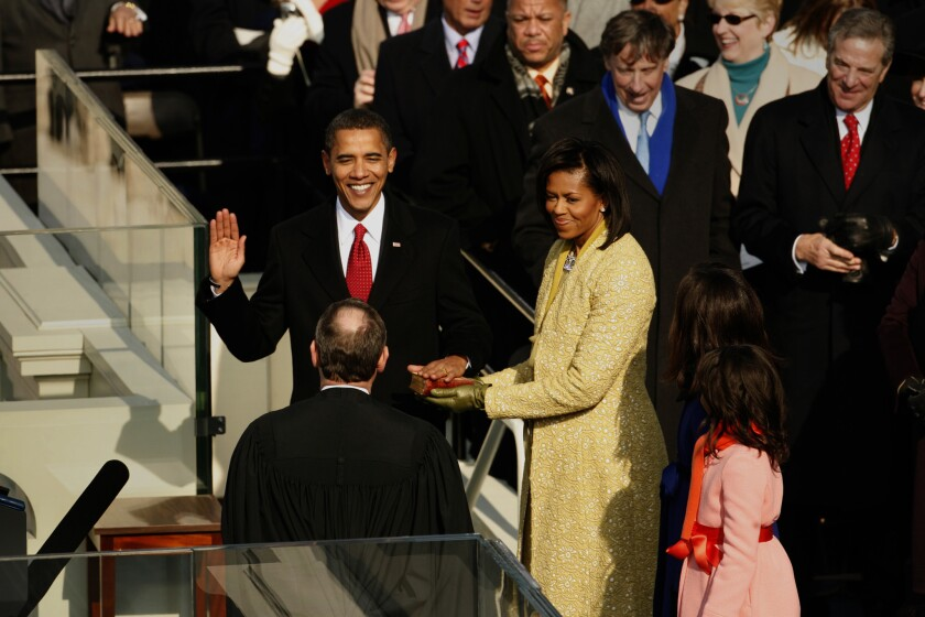 President-elect Barack Obama takes the oath of office accompanied by his family on January 21, 2009.