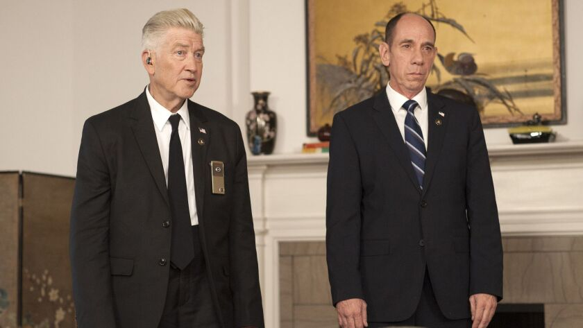 Director, co-writer and recurring player David Lynch, left, with Miguel Ferrer in an scene from Show