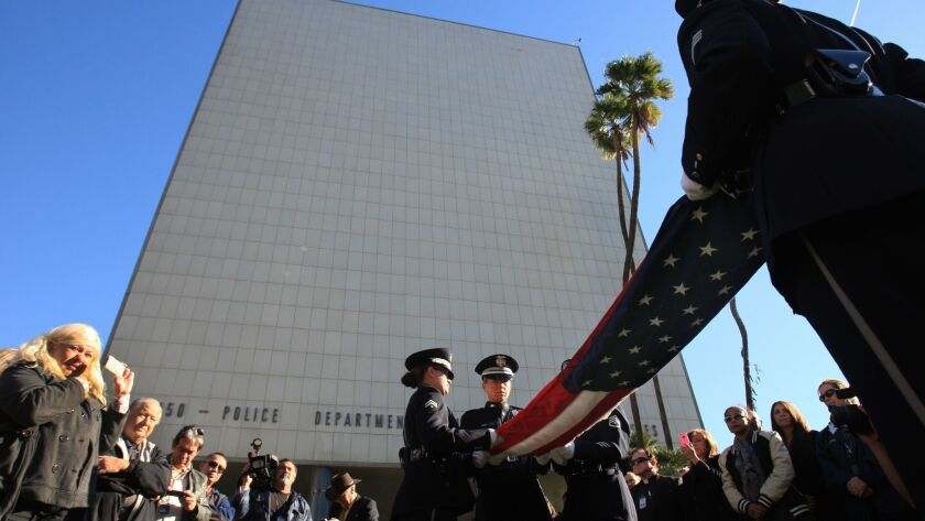 The Parker Center is seen behind an LAPD Honor Guard ceremony from 2013.