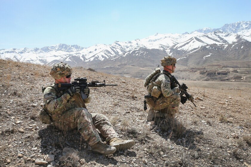 U.S. soldiers patrolling a mountainside in March near Pul-e Alam, Afghanistan.