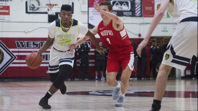 Marina's Jakob Alamudun pushes past Mater Dei's defense during the Charlie Wilkins Memorial Tourname