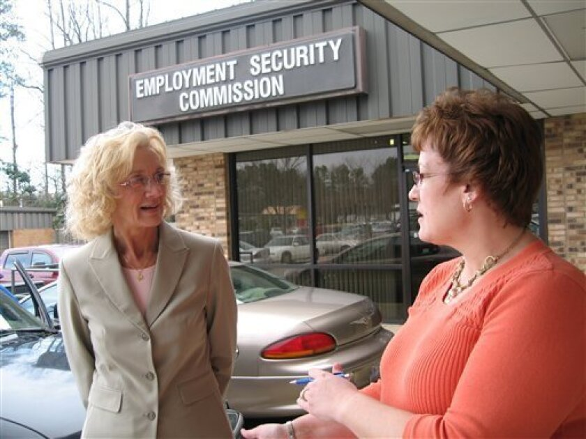 Julie Banner, right, chats with Rebekah Lowe outside the state unemployment office in Cary, N.C., on Thursday, Jan. 8, 2009. The woman were both recently laid off for the first time in their lives and are taking a course to help them in their job search. (AP Photo/Allen G. Breed)