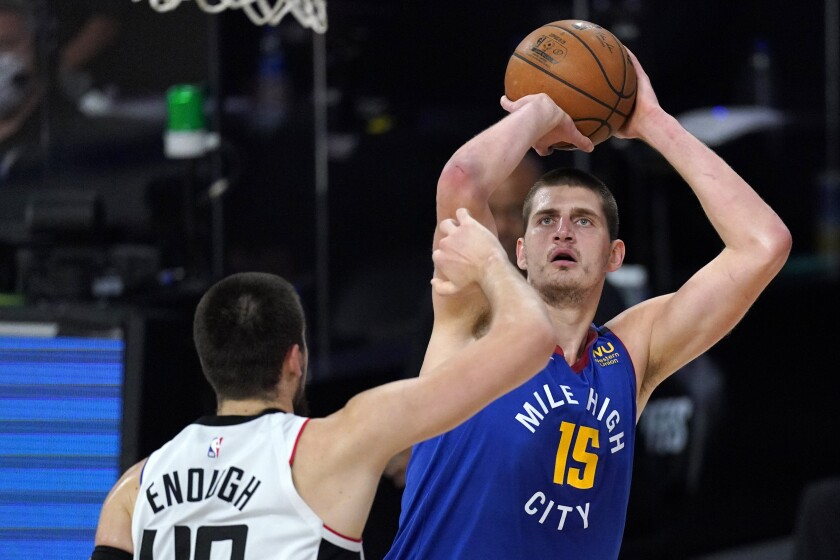 Nuggets center Nikola Jokic shoots over the Clippers' Ivica Zubac.