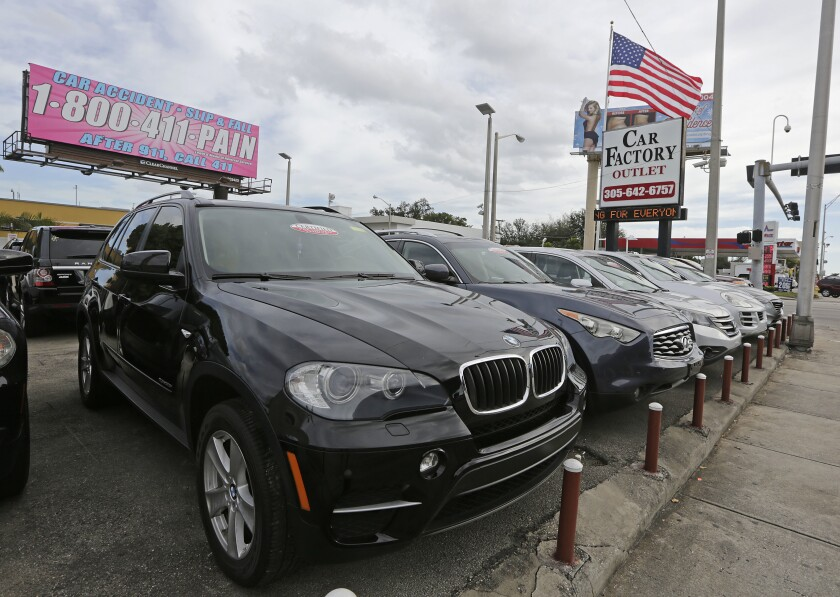 FILE - In this Tuesday, Jan. 17, 2017, file photo, certified pre-owned vehicles sit on display at an auto dealership in Miami. Obtaining a vehicle history report is an integral part of any used-car purchase. It's one of the best ways to learn about a given vehicle's past and help make your search for a used car much easier. (AP Photo/Alan Diaz, File)