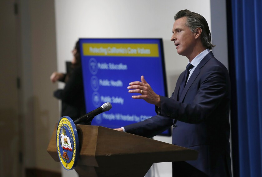 FILE - In this May 14, 2020, file photo, California Gov. Gavin Newsom discusses his revised 2020-2021 state budget during a news conference in Sacramento, Calif. Newsom and some of the state's legislative leaders were among the millions to score federal loans aimed to keep small businesses afloat during the pandemic A Northern California-based winery and hospitality company, PlumpJack, founded by Newsom received a loan worth $150,000 to $350,000 from the Paycheck Protection Program, a national rescue package aimed to help small businesses during the pandemic, according to records released on Monday, July 6, 2020. (AP Photo/Rich Pedroncelli, Pool)