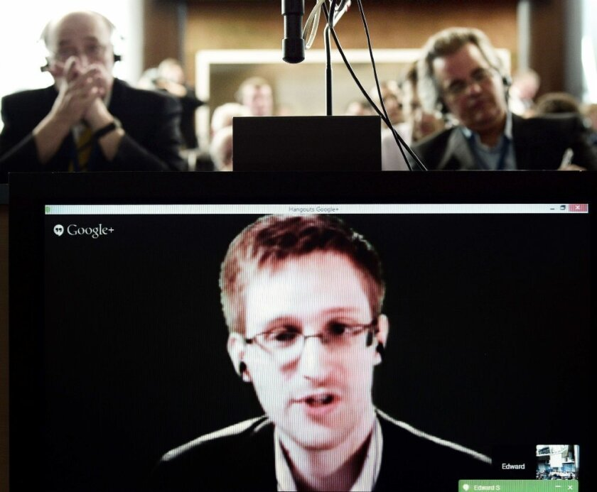 Edward Snowden speaks via videoconference during a hearing on surveillance in France on April 8.