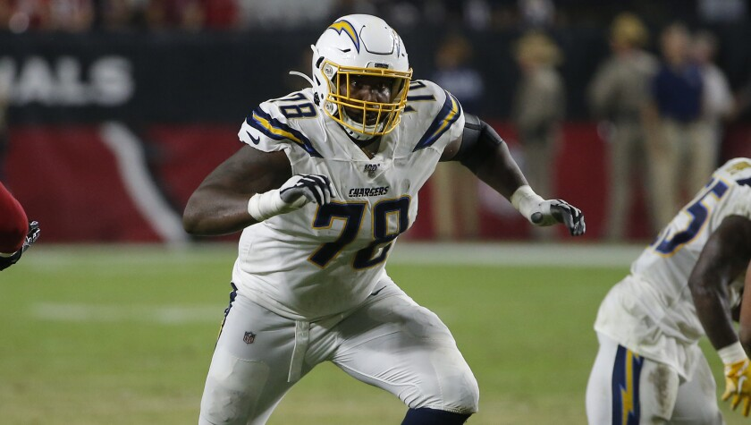 Chargers offensive tackle Trent Scott provides run protection during Thursday's preseason loss to the Arizona Cardinals.