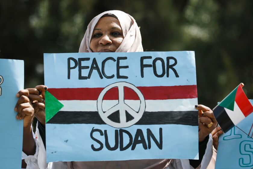 A Sudanese woman joins a protest in Nairobi, Kenya, on June 19, 2019, against Sudan's crackdown on pro-democracy protesters.