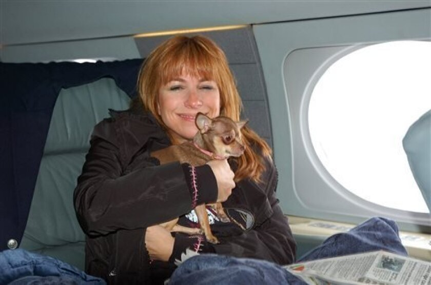 "This undated photo released courtesy Jill Zarin shows ""The Real Housewives of New York City"" actress Jill Zarin, aboard a private jet with her Chihuahua, Ginger in New York on their way to Los Angeles. Zarin had to take a cross-country business trip but 9-year-old dog Ginger was sick. She couldn't leave the 7-pound dog behind, so she hired a vet to go with them. JetsetVets will provide in-flight medical care, prepare animals for their trip, appply for travel documents, work with veterinary hospi"
