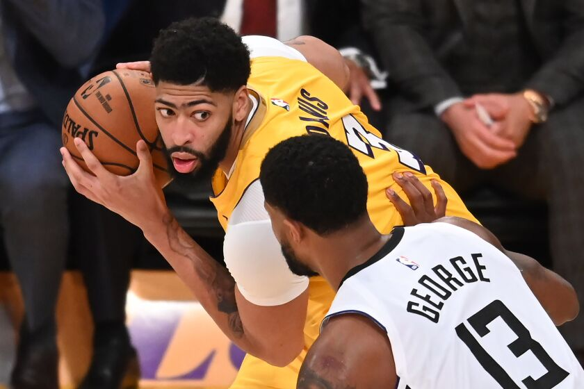All-Star forwards Anthony Davis and Paul George go one-one-one during their game on Dec. 25, 2020.