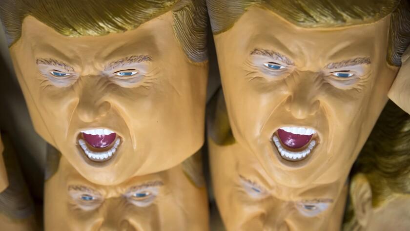 Rubber masks in the likeness of Republican presidential candidate Donald Trump at the Ozawa Studios Inc. factory in Saitama, Japan.