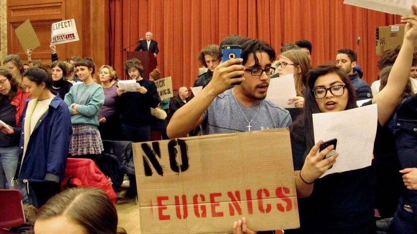 Middlebury College students turn their backs on Charles Murray (at lectern) on March 2. Shouts by protesters effectively ended his appearance.
