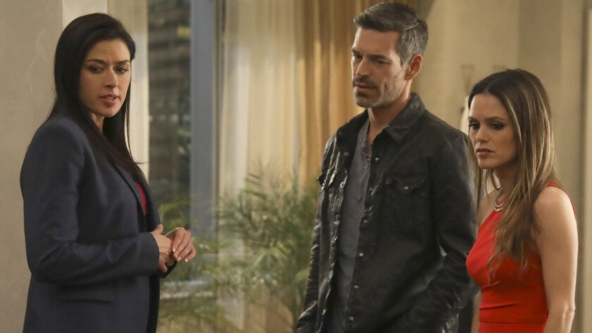 """Aliyah O'Brien, left, Eddie Cibrian and Rachel Bilson in the season finale of the mystery """"Take Two"""" on ABC."""