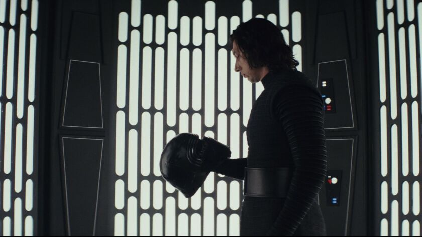 """Adam Driver as 'Kylo Ren' in a scene from the movie """"Star Wars: The Last Jedi."""" Credit: Lucasfilm Lt"""