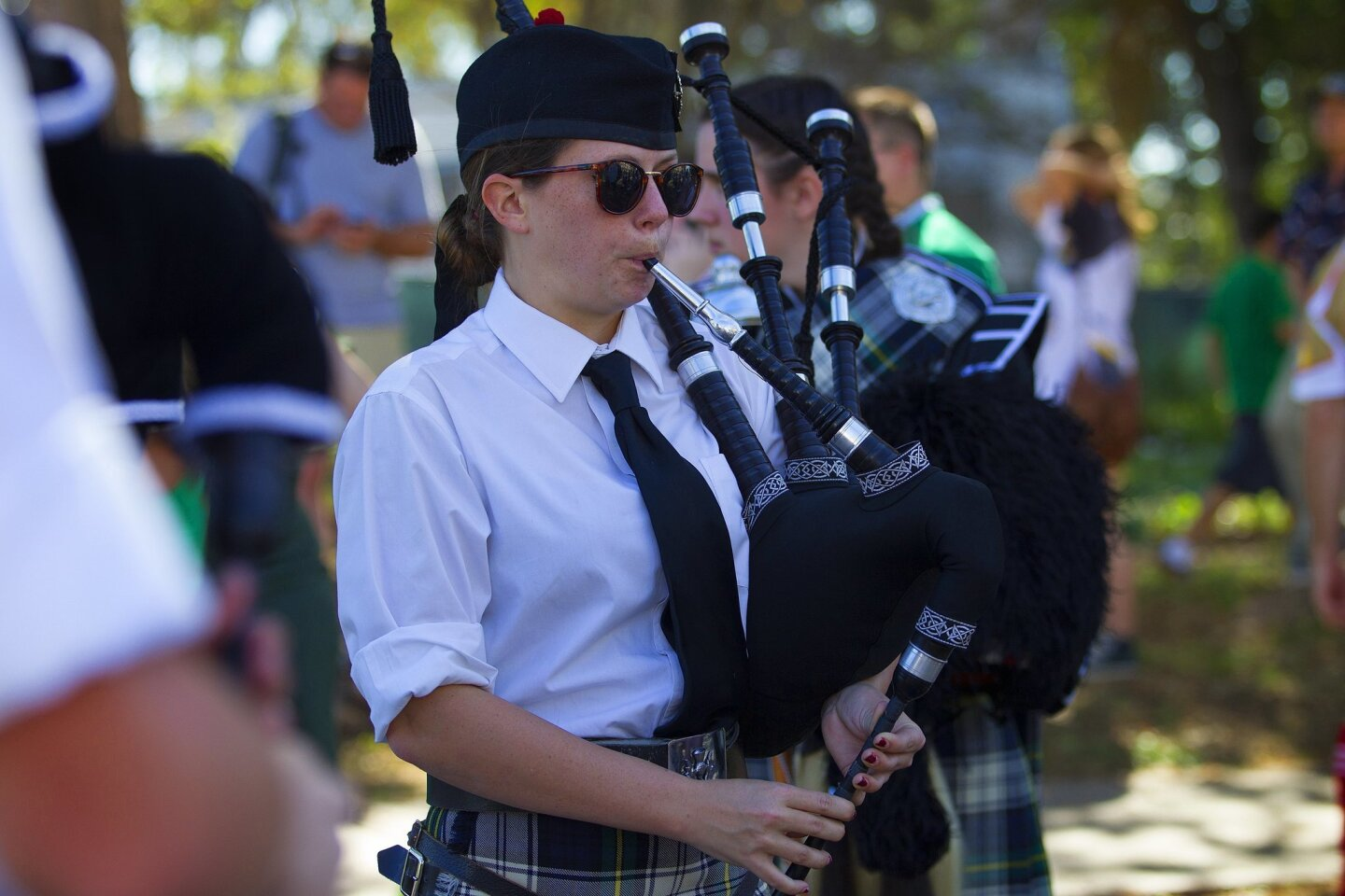 Elizabeth Kelley from Mt. Helix Charter High School's Highlander Pipe Band warms up before the start of the 2015 St. Patrick's Day parade in San Diego.