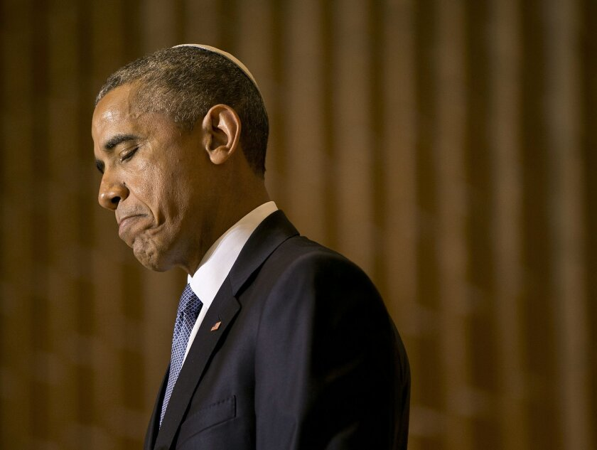President Barack Obama pauses while speaking in honor of Jewish American Heritage Month at Adas Israel Congregation in Washington, Friday, May 22, 2015. The president addressed one of the largest Jewish congregations in Washington to highlight efforts to combat anti-Semitism, a problem he says has created an intimidating environment worldwide for Jewish families. (AP Photo/Pablo Martinez Monsivais)