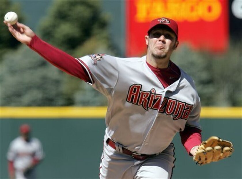 Arizona Diamondbacks starting pitcher Micah Owings delivers a pitch to Colorado Rockies batter Troy Tulowitzki in the first inning of a Major League Baseball game in Denver on Friday, April 4, 2008. (AP Photo/Jack Dempsey)