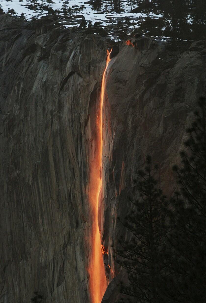 Sunlight creates a glow near Horsetail Fall in Yosemite National Park.