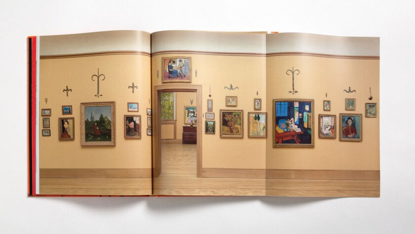 "A fold-out page from ""Matisse in the Barnes Foundation"" shows an installation view of the Barnes collection."