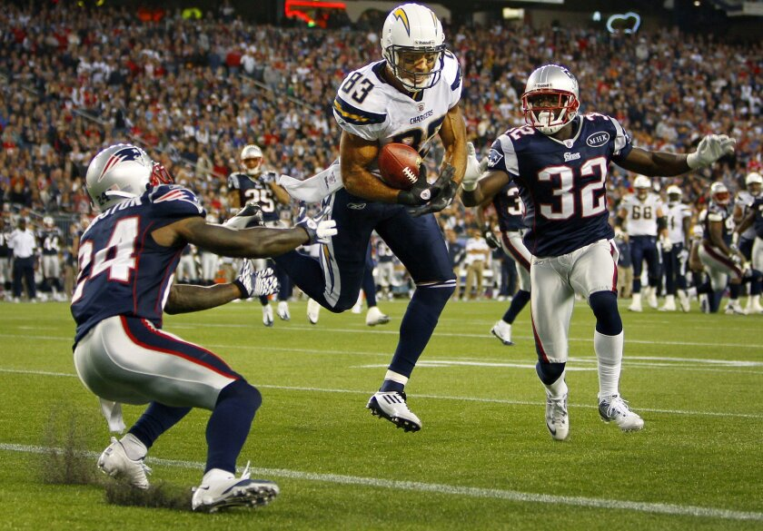 Chargers Vincent Jackson catches a pass for a touchdown as Patriots Kyle Arrington and Devin McCourty, right,  in the 4th quarter.
