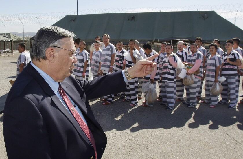 Maricopa County Sheriff Joe Arpaio orders convicts in the U.S. illegally to be handcuffed together in 2009 and moved into tents to serve their sentences before deportation.