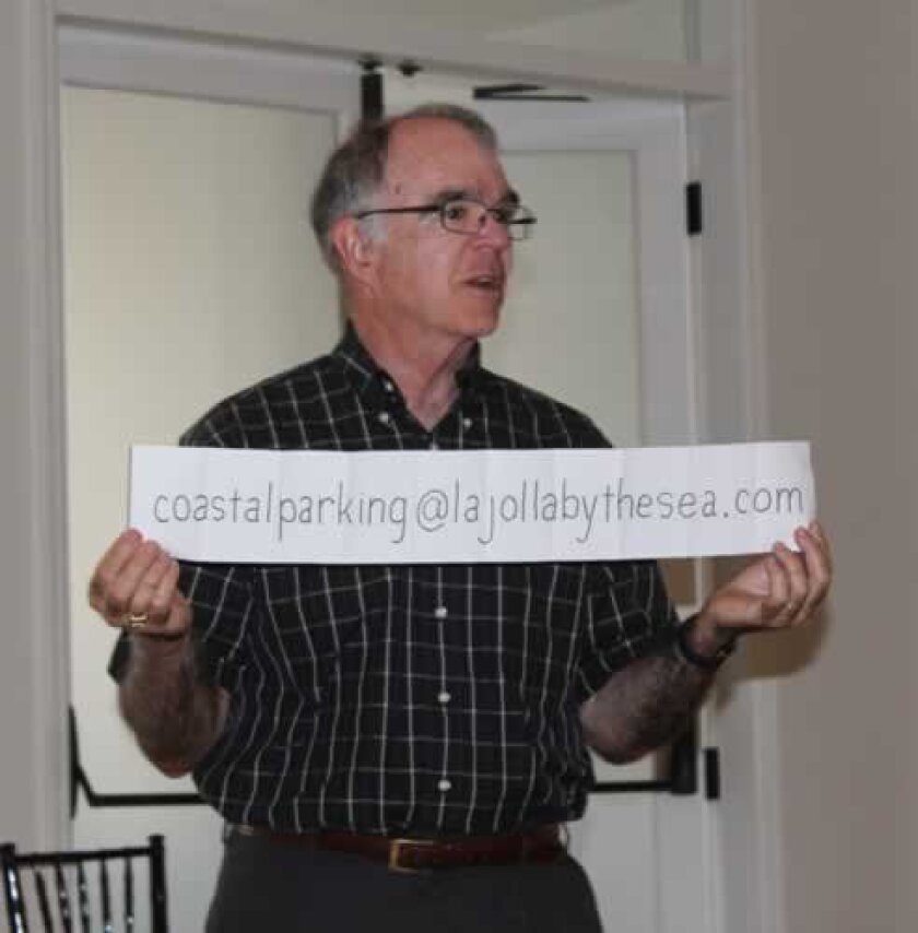 Dan Allen, chair of La Jolla's Coastal Access and Parking Board, displays an e-mail address for the public to send suggestions on easing parking congestion and improving traffic circulation in the Village. The board has upwards of $400,000 that it may use for this purpose.