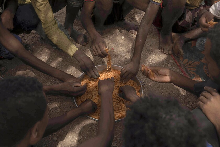 Migrants share spaghetti in Obock, Djibouti.