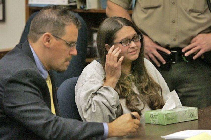 Brae Hansen, 19, shown with her defense lawyer (left) was sentenced to life in prison without parole in 2009 for the murder of her stepfather, attorney Timothy MacNeil, in 2007. Her brother, Nathaniel Gann, 20, was sentenced to 25 years to life. (John Gibbins / Union-Tribune)
