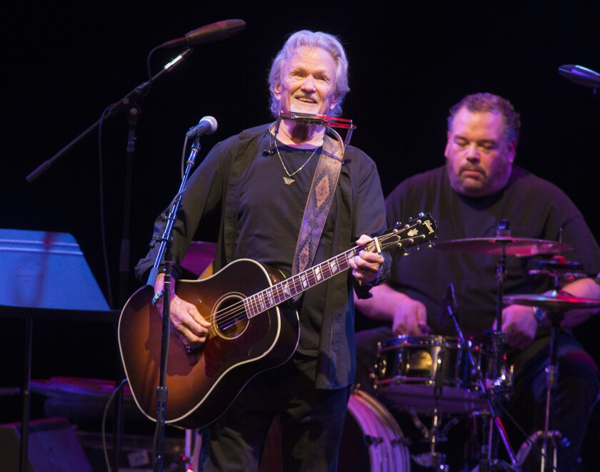 FILE - In this April 12, 2019, file photo, Kris Kristofferson performs in concert at The American Music Theatre in Lancaster, Pa. Kristofferson surprised customers when he performed with an acoustic guitar at a North Dakota bar after a band taped a request to the singer-songwriter's tour bus. Kristofferson stopped at Dempsey's Public House in downtown Fargo on Saturday night, Nov. 9, 2019, and asked to sing with the band 32 Below. (Photo by Owen Sweeney/Invision/AP, File)