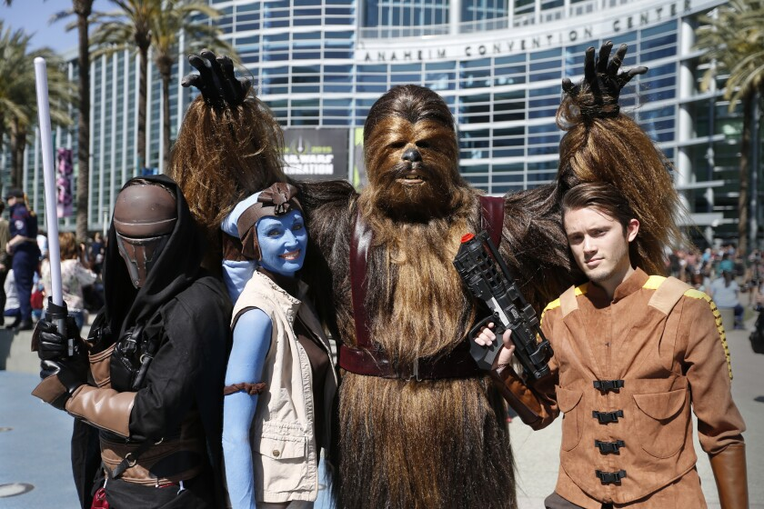 Attendees cosplay at Star Wars Celebration 2015.
