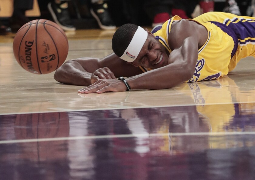 Lakers guard Rajon Rondo falls to the court after being fouled in the first half Nov. 19 against the Oklahoma City Thunder at Staples Center.