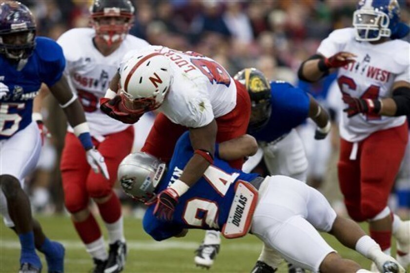 East's Marlon Lucky (20) is tackled in the first half of the annual East-West Shrine college football all-star game on Saturday, Jan. 17, 2009, in Houston. (AP Photo/The Houston Chronicle, Eric Kayne)