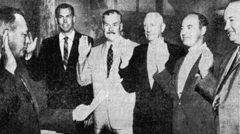 On July 15, 1959, the date when Del Mar officially incorporated, City Clerk Bud James, left, swore in City Council members John Barr, Tom Douglas, Henry Billings, Clayton Jack and Elwood Free.<br>