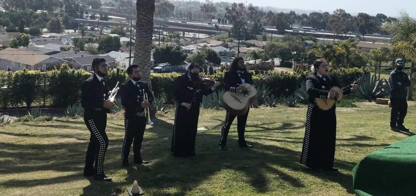 Mariachi Nueva Tradicion de San Diego performs at a funeral for Blanca and Juan Rodriguez at La Vista Memorial Park.