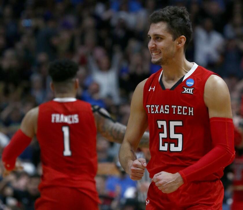 ANAHEIM, CALIF. - MAR. 30, 2019. Texas Tech guard Davide Moretti cel;ebrates after making a three-p