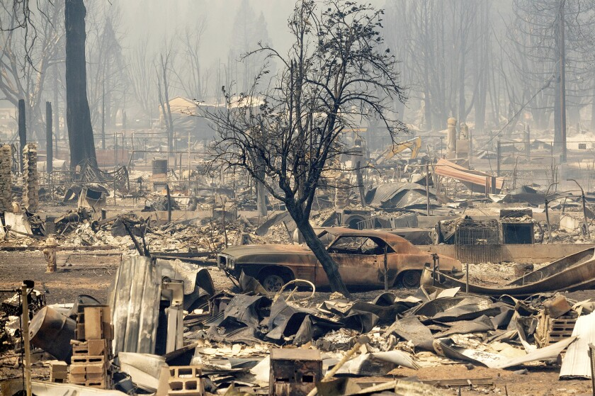 Homes and cars destroyed by the Dixie Fire line central Greenville on Thursday, Aug. 5, 2021, in Plumas County, Calif. (AP Photo/Noah Berger)