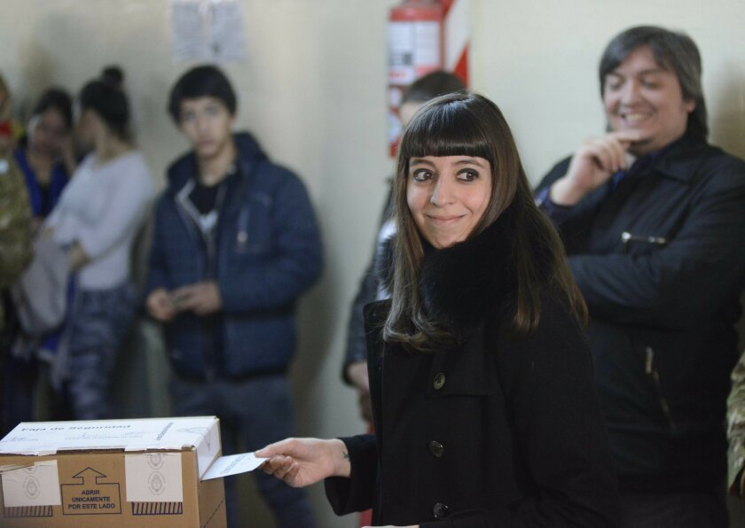 FILE - In this Oct. 25, 2015 file photo, Florencia Kirchner, daughter of Argentina's former President Cristina Fernandez, casts her vote during elections in Rio Gallegos, Argentina. An Argentine prosecutor asked on Friday, July 15, 2016, a local court to seize the more than $4.6 million from the bank safe deposit boxes belonging to the 26-year-old Kirchner, as part of an investigation into alleged money laundering. (AP Photo/Francisco Munoz, File)