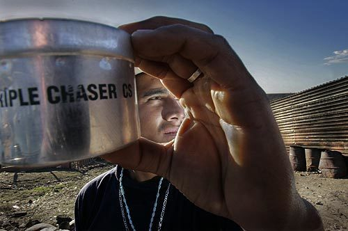 U.S. Border Patrol agents have battled rock-throwing attackers by launching pepper spray and tear gas into Mexican border neighborhoods, according to witnesses, Mexican authorities and human rights groups. Here, Alfredo Aceves, 24, holds a tear gas canister that he says landed in his carpenter shop two weeks ago.