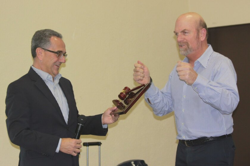 Joe LaCava (left) accepts a plaque for his Honorary Mayorship from La Jolla Town Council President Steve Haskins.