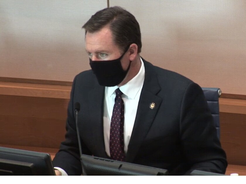 Newport Mayor Will O'Neill wears a face mask during a Newport Beach City Council meeting in April 2020.