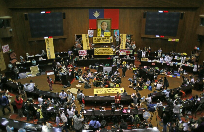 Students occupy the Taiwanese legislative building to protest a trade pact with China.