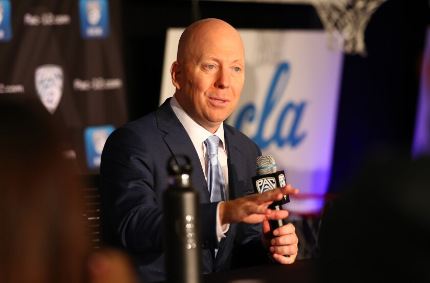 UCLA men's basketball coach Mick Cronin shows off his penchant for style during Pac-12 media day.
