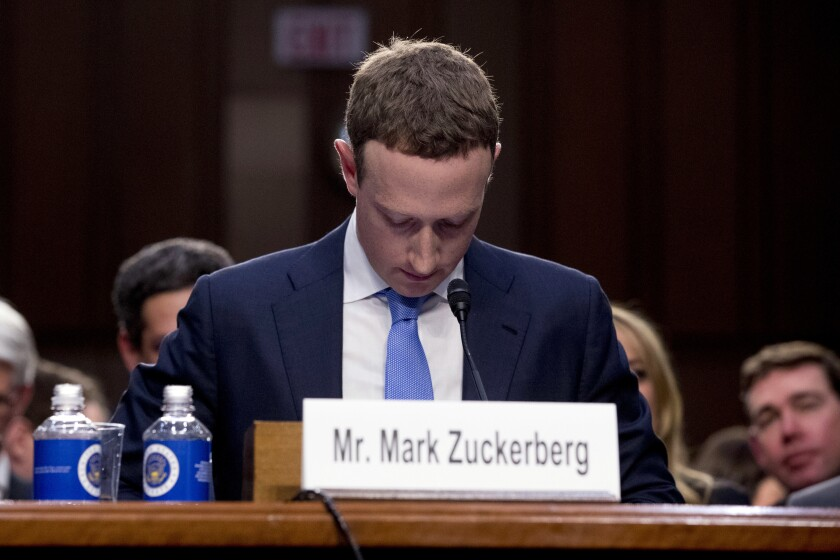 Facebook Chief Executive Mark Zuckerberg pauses during a break in his testimony at a congressional hearing in 2018.
