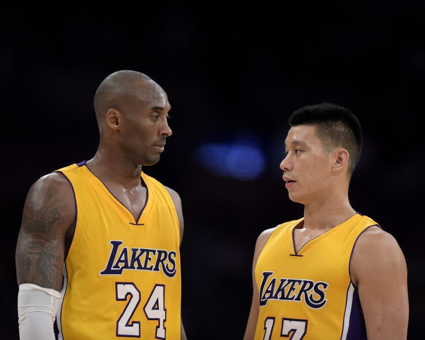 Kobe Bryant and Jeremy Lin take a moment to talk strategy during the Lakers' 112-106 loss to the Phoenix Suns on Tuesday at Staples Center.